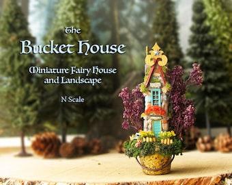 The Enchanted Bucket Fairy House - Miniature Woodland House in a Tiny Bucket - Mossy Roof, Jacaranda Trees, Wildflowers & Fairy Mushrooms
