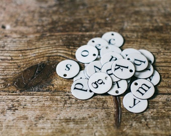 Lettered French Enameled Tags, luggage tags, and labels in Sarif Font