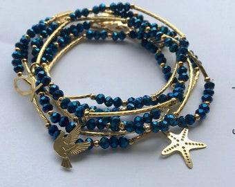 Metallic blue crystal beaded bracelet set (7) with gold plated charms - Semanario pulseras de color azul metalico con dijes chapa de oro