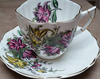 English Porcelain Teacup, Victoria C&E. Teacup and Saucer Set. Cartwright Edwards 1936 and after.