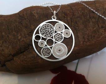 """Meli Melo circle"" pendant"