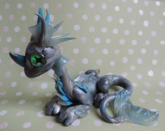 Silver polymer clay water dragon