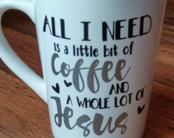 Christmas gift all i need is jesus and coffee mug cup black and silver decal vinyl. Shown on white cup