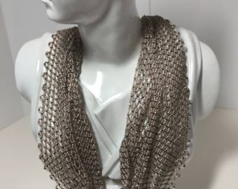 Handwoven beaded scarf necklace in a glimmering sand color