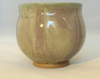 Stoneware pot with swirly glaze