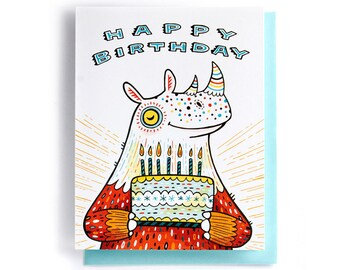 Birthday Card: Rhinoceros with birthday cake, illustrated and hand-lettered in orange and blue