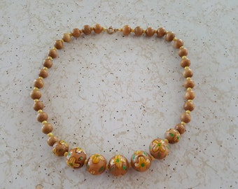 Vintage 1970's wood bead necklace with yellow painted flowers