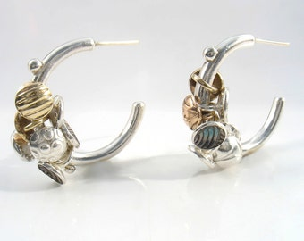 Concaved and curved elements made of rose and yellow gold in combination with shiny,oxidized silver elements,moving freely on Gypsy earrings