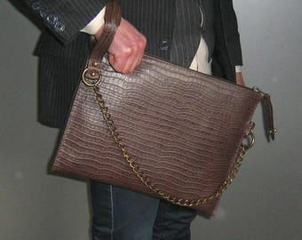 Leather L - curved zipper Brown Clutch designed by DD BESPOKE STUDIO