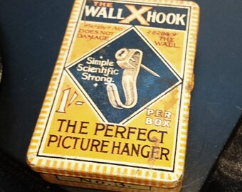 Vintage advertising tin, The Wall X hook, early 20th century