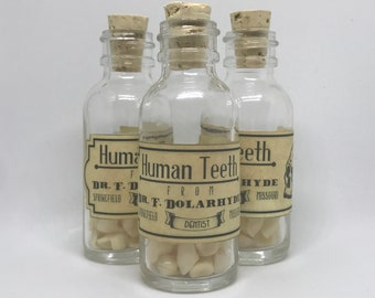 Faux curiosity: resin dentures in glass bottle