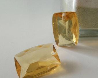 2 plastic rectangle pendants