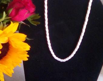 Delicate white bead necklace