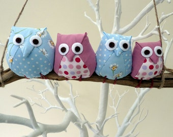 Owls on a branch, 4 pink and blue owls