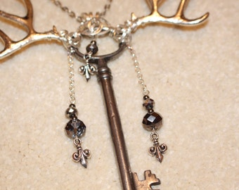 Fleur de Stag - Skeleton key wrapped in silver copper wire, with fleur de lys charms and stag antler charms