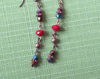 Copper dangle earrings with with copper and red crystals