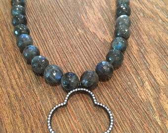 Gorgeous faceted iridescent labardorite necklace with a cubic zirconia quatrefoil pendant