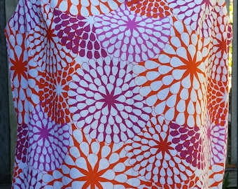 Cool cotton sleeveless top in orange and purple starburst print size 8-10 (small)