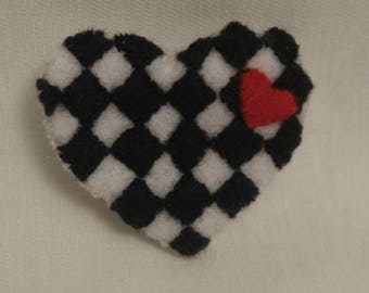 Black and white pin with red heart