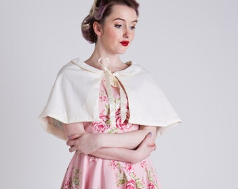 50s inspired ivory occasion / bridal capelet, with a lace peter pan collar and floral pastel lining. Made to order