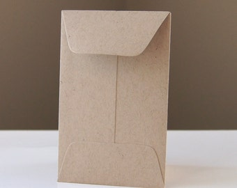 10 Open End Baby Envelopes in Paper Bag .  2.25 x 3.5