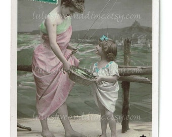 Vintage Tinted Real Photo Postcard of a Mother and Daughter Fishing - France