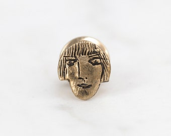 Girl face lapel pin - brass