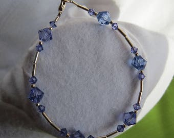 Tanzanite colored crystals in silver bracelet