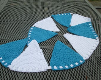 Hand knitted bunting in turquoise and white