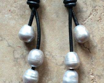 Leather and pearl earrings.