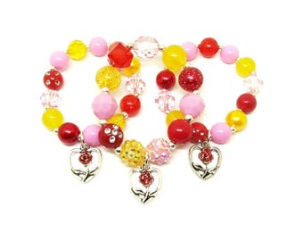 Beauty and the Beast bracelets party favors in organza bags with special birthday girl bracelet!