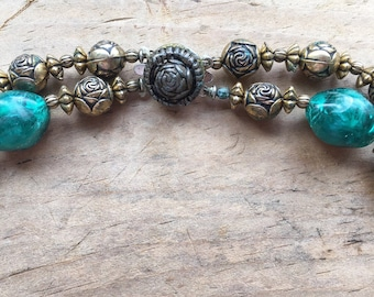 Vintage metal gold copper tone rosettes and teal/blue/green beads double strand necklace with rosette clasp