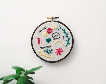 "Embroidery - Doodles hand embroidered 4"" wall hanging (oh, D, arrow, eyes)"
