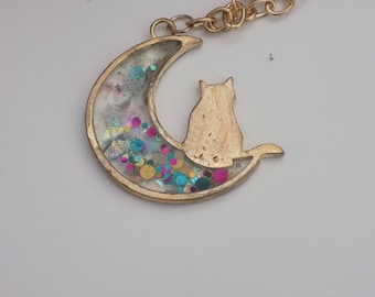 cat necklace on the moon