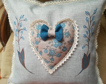Hand painted grey pillow with blue heart