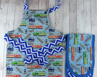 Trains, Apron and Oven Gloves - 18mths-3yrs. 2 designs. Fully Reversible & Adjustable. Play Apron and Play Oven Gloves. Co-ordinating items.