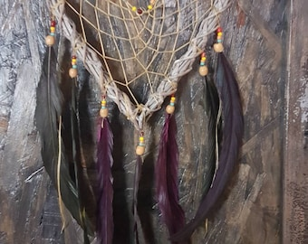 Dream catcher, heart, mystical magic. Dream catcher, Rooster feathers.  Animal Totem medicine. Native American spirituality on vine