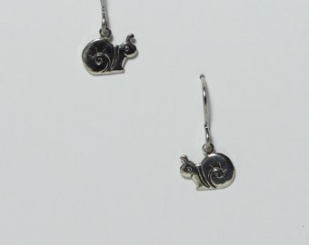 Tiny snail earrings on hypoallergenic surgical steel ear wires
