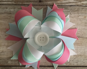 Over the top button bow