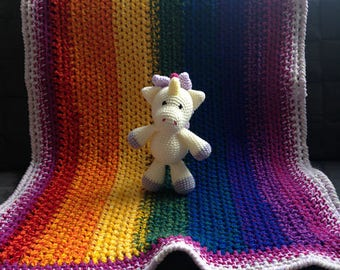 Crocheted rainbow baby blanket with stuffed animal Elina Unicorn
