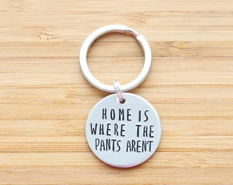 hand stamped keychain   home is where the pants aren't