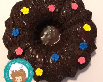 moist Chocolate Bundt Cake with fondant decorations