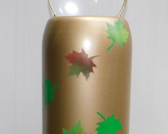 Tank bell wind chime or gong with falling leaves