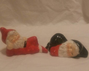 Two vintage sleeping porcelain Christmas elves