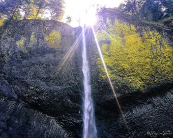 Waterfall and sunburst photograph