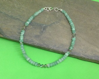A beautiful Emerald and Swarovski sterling silver bracelet.