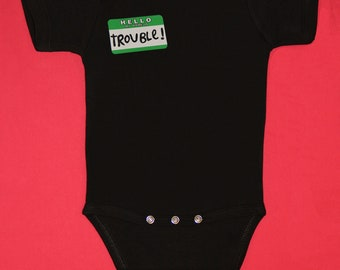Hello My Name Is Trouble pink or black, long or short sleeve, and green long sleeve one piece baby body suit.