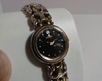 Seiko Ladies watch black face diamond at 12:00