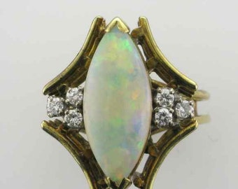 14 Karat Yellow Gold Opal and Diamond Ring with Angular Motif