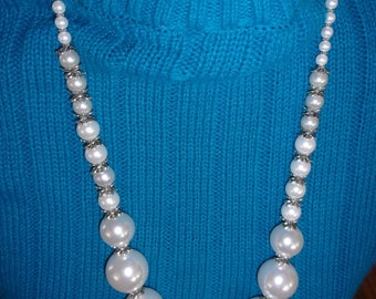 Simulated pearls with silver jackets